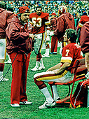 Washington Redskins offensive coordinator Joe Walton, left, discusses strategy on the sidelines with Redskins quarterback Joe Theismann (7), right, during the game against the New Orleans Saints at RFK Stadium in Washington, DC on Sunday, October 28, 1979.  The Saints won the game 14 - 10.  Redskins offensive guard Fred Dean (63) is visible in the background towards the center of the photo.<br /> Credit: Armie Sachs / CNP