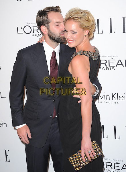Josh Kelley & Katherine Heigl.18th Annual ELLE Women in Hollywood celebration held at The Four Seasons in Beverly Hills, California, USA..October 17th, 2011.half length black dress sleeveless silver gold beads beaded trim clutch bag suit beard facial hair side arm around waist kiss kissing.CAP/RKE/DVS.©DVS/RockinExposures/Capital Pictures.
