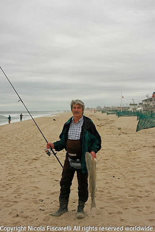 Fisherman fishes of the New Jersey coast at Silver Beach.