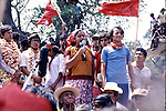 File photo by March, 1981. Zapotec Native teacher Candida Santiago gives a speech about his husband Victor Pineda who was disappeared by Mexican soldiers on July 11, 1979, as Leopoldo de Gyves takes office as municpality president of Juchitan in southern state of Oaxaca. At Candida Santiago's left hand appears teacher Enedino Jimenez and newly president Leopoldo De Gyves appears at far left. Photo by Heriberto Rodriguez