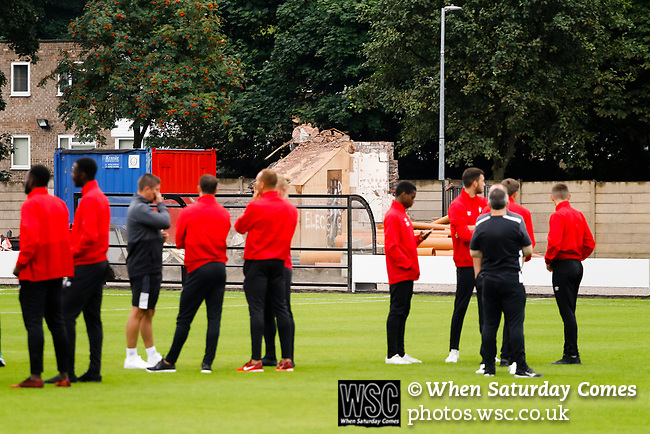 Salford City 2 FC United of Manchester 1, 15/07/2017. Moor Lane, Pre Season Friendly. Salford players inspect the pitch with the remains of the old Main Stand in the background. Salford City v FC United of Manchester in a pre season friendly at Moor Lane Salford. Photo by Paul Thompson.