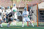 La Canada Flintridge, CA 03/16/13 - Payden Dickerson (De La Salle #10) and Jake Stott (Coronado #15) in action during the De La Salle vs Coronado lacrosse game at St Francis High School.  De La Salle defeated Coronado 8-5.