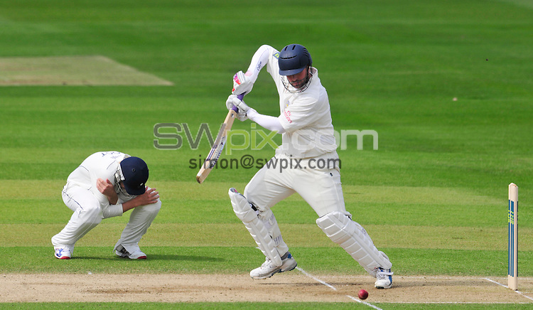 PICTURE BY SIMON WILKINSON/SWPIX.COM...Cricket - LV County Championship - Yorkshire v Durham, Day Two - Headingley, Leeds, England - 16/04/11...Yorkshire's close fielder takes evasive action from Durham's Ian Blackwell.
