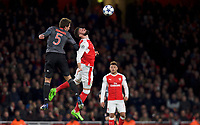 Olivier Giroud of Arsenal wins the header from Mats Hummels of Bayern Munich during the UEFA Champions League round of 16 match between Arsenal and Bayern Munich at the Emirates Stadium, London, England on 7 March 2017. Photo by Alan  Stanford / PRiME Media Images.