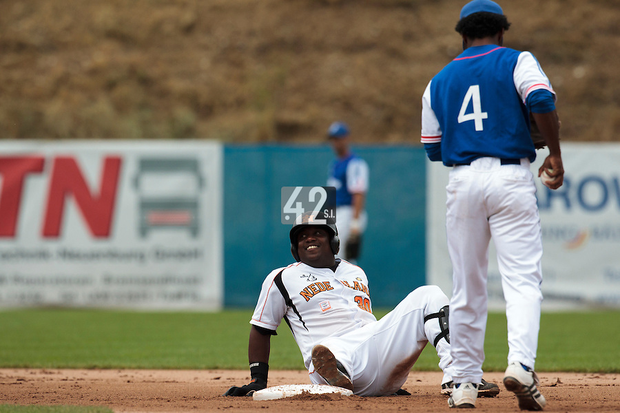 24 july 2010: Raylinoe Legito of Netherlands smiles as he falls safely into second base during Netherlands 10-0 victory over France, in day 2 of the 2010 European Championship Seniors, in Neuenburg, Germany.