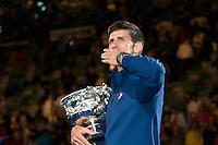 January 31, 2016: Novak Djokovic of Serbia celebrates winning the Men's Final against Andy Murray of United Kingdom on day fourteen of the 2016 Australian Open Grand Slam tennis tournament at Melbourne Park in Melbourne, Australia. Novak Djokovic won 61 75 76. Photo Sydney Low