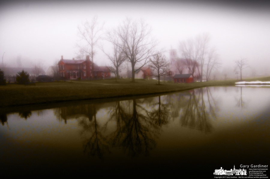 Everal Barn and homestead farm in an early morning fog.
