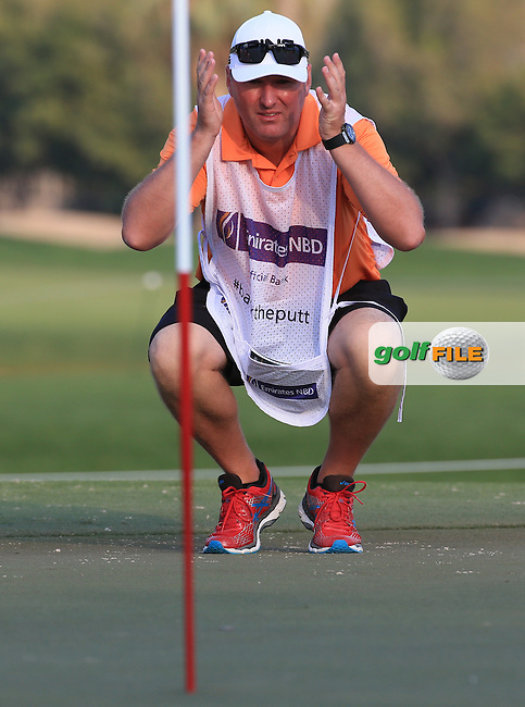 Caddie Sean McDonagh during the Pro-Am at the 2016 Omega Dubai Desert Classic, played on the Emirates Golf Club, Dubai, United Arab Emirates.  03/02/2016. Picture: Golffile | David Lloyd<br /> <br /> All photos usage must carry mandatory copyright credit (&copy; Golffile | David Lloyd)