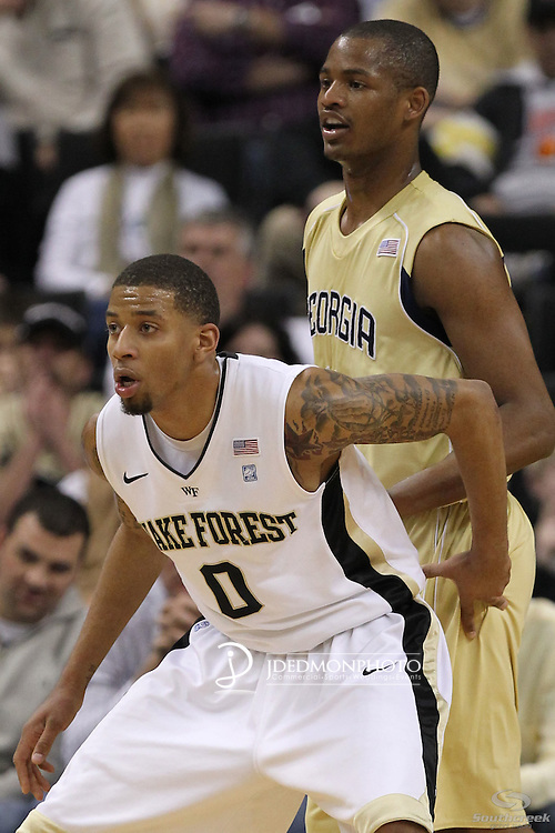 Georgia Tech Yellow Jackets guard Jason Morris (14) looks for the outlet pass as Wake Forest Demon Deacons guard J.T. Terrell (0) tries to block him out. Georgia Tech leads at the half 35-28.