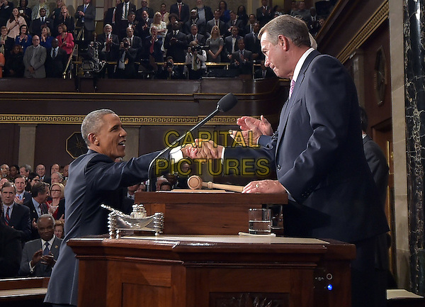 US President Barack Obama shakes hands with Speaker of the House John Boehner as he arrive to deliver the State of The Union address on January 20, 2015, at the US Capitol in Washington, DC.  <br /> CAP/MPI/MAN<br /> &copy;MAN/MPI/Capital Pictures