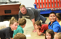 NWA Democrat-Gazette/FLIP PUTTHOFF <br />FITNESS CHALLENGE<br />Dan Blom with Nestle USA does push ups Wednesday May 10 2017 with youngsters during the Nestle Boys & Girls Club Fitness Challenge held at Benton County Boys & Girls Club in Bentonville. Kids took part in several fitness events, including jump rope, push ups, basketball and sit ups. The fitness challenge is a national event at 750 Boys & Girls Clubs that involves about 75,000 youngsters, said Ginger Brooks with Nestle USA.