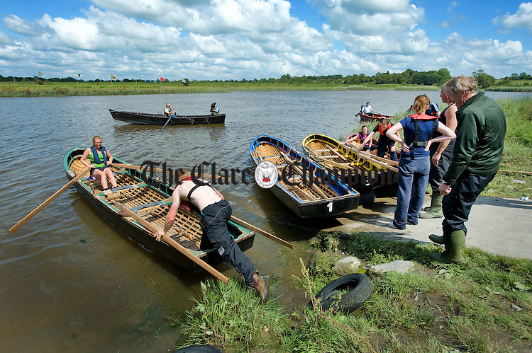 Eoin Honan pushes off the currach which he raced in with Leah O Sullivan, at the annual regatta and fun day at Clarecastle. Photograph by John Kelly.