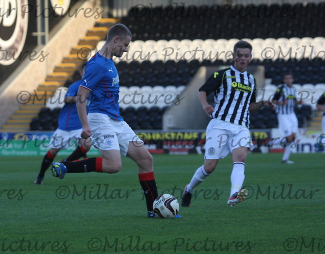 Greg Pascazio being closed down by Thomas Reilly in the St Mirren v Rangers Scottish Professional Football League Under 20 match played at St Mirren Park, Paisley on 10.9.13.