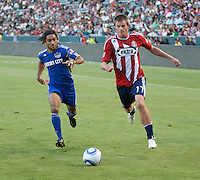 CARSON, CA – SEPTEMBER 19: KC Wizard midfielder Stephane Auvary (8) and Chivas USA forward Justin Braun (17) during a soccer match at Home Depot Center, September 19, 2010 in Carson California. Final score Chivas USA 0, Kansas City Wizards 2.