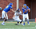BROOKINGS, SD - SEPTEMBER 24:  Taryn Christion #3 from South Dakota State University scrambles away from Pete Swenson #50 from Western Illinois in the first half of their game Saturday evening at Dana J. Dykhouse Stadium in Brookings. (Photo by Dave Eggen/Inertia)