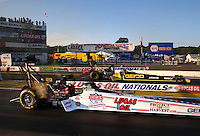 Aug 15, 2014; Brainerd, MN, USA; NHRA top fuel dragster driver Morgan Lucas (near) races alongside teammate Richie Crampton during qualifying for the Lucas Oil Nationals at Brainerd International Raceway. Mandatory Credit: Mark J. Rebilas-