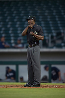 Home plate umpire Demetrius Hicks between innings of an Arizona League game between the AZL Cubs 1 and the AZL Brewers at Sloan Park on June 29, 2018 in Mesa, Arizona. The AZL Cubs 1 defeated the AZL Brewers 7-1. (Zachary Lucy/Four Seam Images)