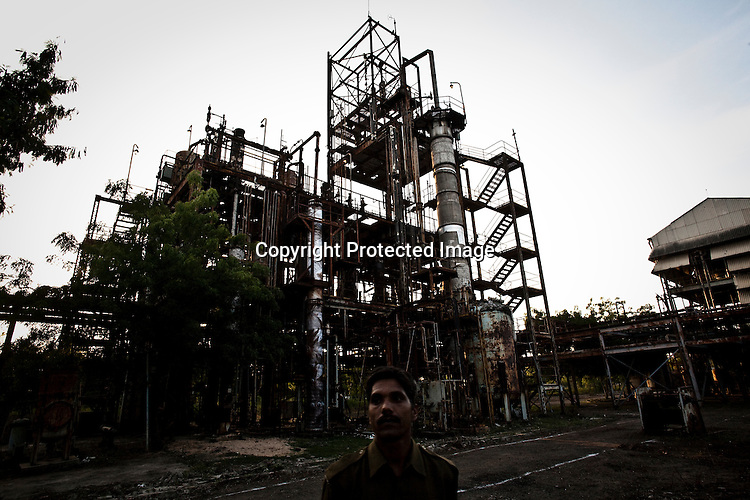 A police man looks on as he tours the site of the deserted Union Carbide factory in Bhopal, India. Twenty-five years after an explosion causing a mass gas leak, in the Union Carbide factory in Bhopal, killed at least eight thousand people, toxic material from the 'biggest industrial disaster in history' continues to affect Bhopalis. A new generation is growing up sick, disabled and struggling for justice. The effects of the disaster on the health of generations to come, both through genetics, transferred from gas victims to their children and through the ongoing severe contamination, caused by the Union Carbide factory, has only started to develop visible forms recently. Photograph: Sanjit Das
