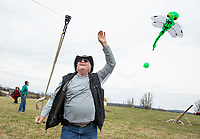 NWA Democrat-Gazette/BEN GOFF @NWABENGOFF<br /> Gerald Menees of Dallas launches his 30-foot dragonfly kite Saturday, March 23, 2019, during the 29th annual Eureka Springs Kite Festival hosted by Turpentine Creek Wildlife Refuge in Eureka Springs. The free family event included kite making and kites for sale from Keleidokites in Eureka Springs and a variety of food trucks and entertainment. Strong wind kept dozens of kites flying high at any given time. Menees and his wife Nancy brought several large kites, including a 50 foot dragon. They said they travel to many kite events around the country.