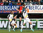 Nederland, Nijmegen, 2 december 2012.Eredivisie .Seizoen 2012-2013.N.E.C.-NAC Breda.Michel Breuer (midden.) van N.E.C. en Nemanja Gudelj (r.) van NAC Breda strijden in een kopduel om de bal. Links Elson Hooi van NAC Breda.