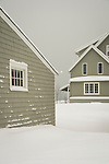 Shoreline cottage in winter and fresh snow.