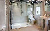 BNPS.co.uk (01202 558833)<br /> Pic: PurpleBricks/BNPS<br /> <br /> Giveaway... the distintive shape of a railway carriage in the ceiling of this bathroom. <br /> <br /> This £475,000 seaside cottage contains a charming secret – it's built around two Victorian railway carriages.<br /> <br /> The 19th century carriages were used as temporary housing for soldiers returning from the First World War when there was a shortage of homes.<br /> <br /> But many of them remained in place years later and had bricks and mortar built around them.<br /> <br /> And so from the street view they looked like normal houses but inside the main reception rooms were with the converted carriages.