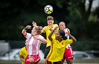 Ruby Baxter of Watford Ladies beats Dom Godbeer of Stevenage Ladies to the ball during the pre season friendly match between Stevenage Ladies FC and Watford Ladies at The County Ground, Letchworth Garden City, England on 16 July 2017. Photo by Andy Rowland / PRiME Media Images.