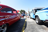 NWA Democrat-Gazette/FLIP PUTTHOFF <br /> COFFEE AND CARS<br /> Vintage cars and trucks draw a crowd on Saturday July 7 2018 at the monthly Coffee and Cars event in downtown Springdale. Coffee and Cars takes place the first Saturday of the month April through October along Emma Avenue south of Shiloah Square. Saturday's show had a patriotic theme to honor Independence Day. There's no charge for vehicle owners to enter the car show, and people can vote for their favorite cars and trucks. Winners get plaques, said Jennifor Joyner with Downtown Springdale Alliance.