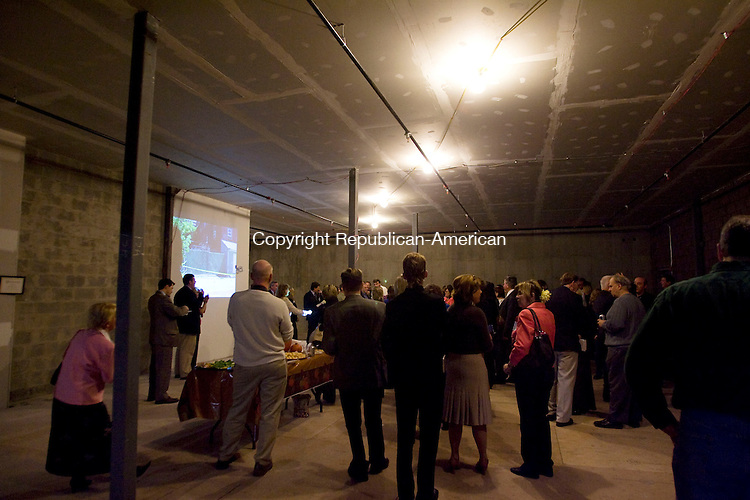 WATERBURY, CT - 20 OCTOBER 2009 -102009JT02-<br /> A crowd gathers inside the unfinished Meadow Street Commons, the new office building next to the Crossroads Cantina, during a Waterbury Chamber of Commerce Out for Business event on Tuesday.<br /> Josalee Thrift Republican-American