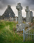 Isle of Skye, Dunvegan, Scotland:<br /> Stone celtic corsses in the Old St Mary's Church yard under stormy skies