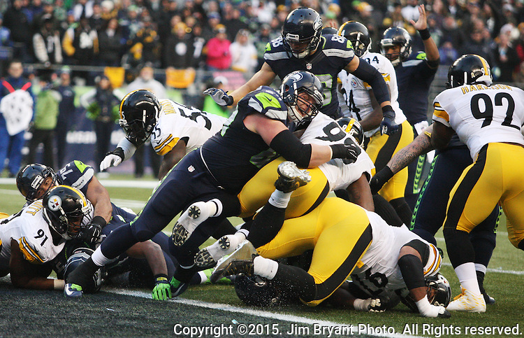 Seattle Seahawks running back Thomas Rawls (34) scores a one-yard touchdown in the third quarter against the Pittsburgh Steelers at CenturyLink Field in Seattle, Washington on November 29, 2015.  The Seahawks beat the Steelers 39-30.      ©2015. Jim Bryant Photo. All Rights Reserved.