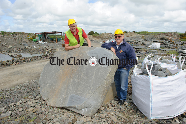 Pat Mc Inerney of West Clare Ballykett Quarry and  Manuel Di Lucia with the memorial stone which he is looking to erect at Kilkee in memory of people lost at sea. Photograph by John Kelly