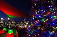 Charlotte Christmas - Uptown Charlotte North Carolina skyline is a beautiful Christmas  holiday backdrop against  a decorated Christmas tree located on the City Lights Rooftop in Charlotte, North Carolina.<br /> <br /> Charlotte Photographer - PatrickSchneiderPhoto.com