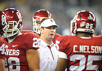 Jan. 1, 2011; Glendale, AZ, USA; Oklahoma Sooners head coach Bob Stoops in the huddle with his players in the first quarter against the Connecticut Huskies in the 2011 Fiesta Bowl at University of Phoenix Stadium. Mandatory Credit: Mark J. Rebilas-