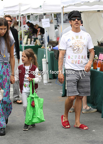 What the heck is he wearing? Hotel slippers??? Anthony Kiedis went shopping on a local farmers market with his much younger girlfriend Helena Vestergaard, and his son, Everley Bear. Los Angeles, California on June 23, 2013<br />