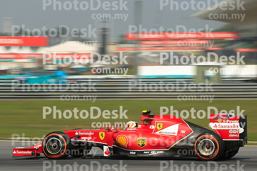 KUALA LUMPUR, MALAYSIA - MARCH 28: Ferrari driver Kimi Räikkönen in action during the first practice session during the Malaysia Formula One Grand Prix at the Sepang Circuit on March 28, 2014 in Kuala Lumpur, Malaysia. (Photo by PETER LIM/PhotoDesk.com.my)