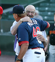 June 20th 2008:  Former Major League Manager Joe Altobelli hugs Dyar Miller, a roving coach for the St. Louis Cardinals, during a game at Frontier Field in Rochester, NY - home of the Rochester Red Wings.  Photo by:  Mike Janes/Four Seam Images