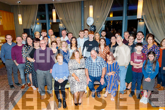 Michelle Carroll and Paul Cunningham, both from Abbeydorney, seated centre, celebrated their engagement in the Ballyroe Heights hotel, Tralee last Saturday night with many family and guests.