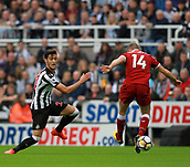 1st October 2017, St James Park, Newcastle upon Tyne, England; EPL Premier League football, Newcastle United versus Liverpool; Mikel Merino of Newcastle United slides the ball past Jordan Henderson of Liverpool in the 1-1 draw
