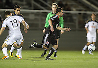Stephen King(7) of D.C. United breaks past Jack McInerney(19) and Roger Torres(8) of the Philadelphia Union during a play-in game for the US Open Cup tournament at Maryland Sportsplex, in Boyds, Maryland on April 6 2011. D.C. United won 3-2 after overtime penalty kicks.