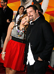 "HOLLYWOOD, CA. - November 17: Actress/Singer Miley Cyrus and actor John Travolta arrive at the World Premiere of Walt Disney's ""Bolt"" at the El Capitan Theatre on November 17, 2008 in Hollywood California."