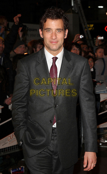 "CLIVE OWEN .""Duplicity"" World Premiere arrivals at the .Empire cinema, Leicester Square, London, England, 10th March 2009..half length grey gray suit red maroon tie white shirt hand in pocket .CAP/ROS.©Steve Ross/Capital Pictures"