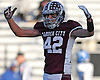 Andrew DeSantis #42 of Garden City reacts after a defensive stop on fourth down gave the ball back to the Trojans in the third quarter the Nassau County varsity football Conference II semifinals against Long Beach at Hofstra University on Saturday, Nov. 12, 2016. Garden City won by a score of 36-8.