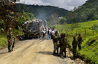 TUTUNENDO, COLOMBIA - DECEMBER 22, 2016: Colombian Soldiers stand next to a Bus attacked by members of the National Liberation Army (ELN) near Tutunendo Choco. local media said. Photo by VIEWpress/Guillermo Betancur