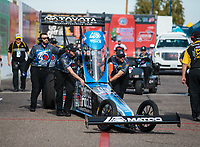 Feb 24, 2019; Chandler, AZ, USA; Crew members with NHRA top fuel driver Antron Brown during the Arizona Nationals at Wild Horse Pass Motorsports Park. Mandatory Credit: Mark J. Rebilas-USA TODAY Sports