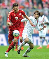 FUSSBALL   1. BUNDESLIGA  SAISON 2011/2012   29. Spieltag FC Bayern Muenchen - FC Augsburg       07.04.2012 Mario Gomez (li, FC Bayern Muenchen) gegen Hajime Hosogai (FC Augsburg)