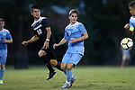 ELON, NC - AUGUST 25: Providence's Danny Griffin (10) sends the ball past North Carolina's Jack Skahan (8). The University of North Carolina Tar Heels hosted the Providence College Friars on August 25, 2017 at Rudd Field in Elon, NC in a Division I college soccer game. UNC won the game 4-2.