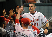 Sept. 17, 2009: Third baseman Will Middlebrooks (11) of the Greenville Drive is congratulated after scoring the go-ahead run in Game 3 of the South Atlantic League Championship Series at Fluor Field at the West End in Greenville, S.C. The Drive beat the Lakewood BlueClaws 3-2 but trail in the best-of-five series 2-1.   Photo by: Tom Priddy/Four Seam Images