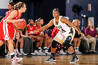 28 January 2012:  FIU guard Kamika Idom (14) defends WKU guard Ellen Sholtes (11) in the second half as the FIU Golden Panthers defeated the Western Kentucky University Hilltoppers, 60-56, at the U.S. Century Bank Arena in Miami, Florida.