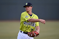 Infielder Brian Sharp (7) of the Columbia Fireflies warms up before a game against the Charleston RiverDogs on Thursday, April 4, 2019, at Segra Park in Columbia, South Carolina. Charleston won, 2-1. (Tom Priddy/Four Seam Images)